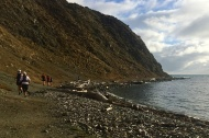 Running along Makara beach
